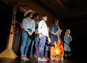 """Children who are part of the Special Learning Center sing around a """"campfire"""" in their opening scene of the annual Moments of Magic show Feb. 21 at the DoubleTree by Hilton Hotel Jefferson City. Photos by Liv Paggiarino"""